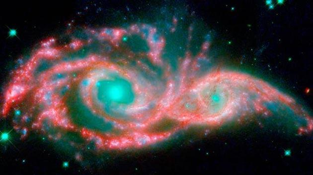 NGC 2207 i IC 2163 (dvije galaksije udaljene oko 140 miliona svjetlosnih godina od Zemlje )